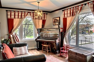 Main floor living room with 1903 piano