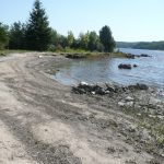Farr Island beach on west side of the island. This is a unique feature for lake Temiskaming as the rough waters often prevent the formation of a beach. The beach is located on the west side and it does not get affected by the strong north-east winds. / LA plage de l'île Farr sur le côté ouest. La présence d'une plage est assez rare sur le lac Témiskaming à cause des fort vents.